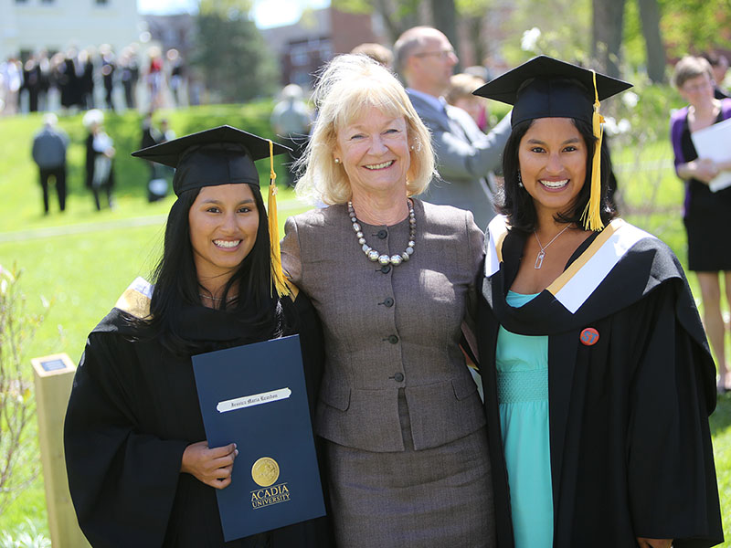 A professor with her graduates