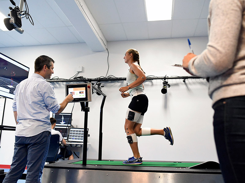 Researchers work with student-athletes inside the mLab