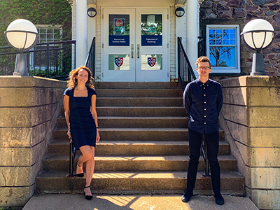 Drs. Anne-Sophie Champod and Daniel Lametti stand in front of the steps of Horton Hall after the announcement of their new research centre funding.