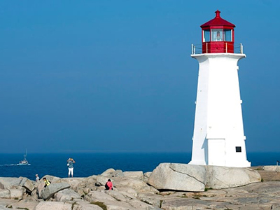 Peggy's Cove lighthouse on a clear day. Photo credit: Andrew Vaughan/Canadian Press