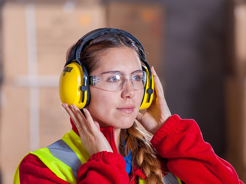 A worker puts on ear protection.