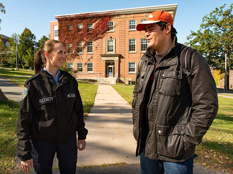 Shift Supervisor Eden Jordan provides chats with a student outside of Rhodes Hall.